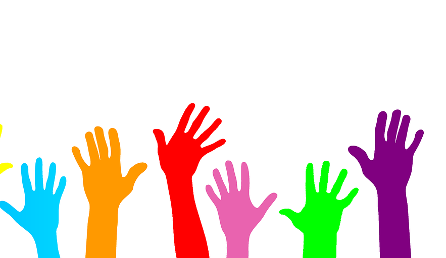 hands rasied to volunteer
